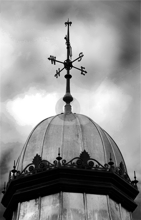 Weather Vane Compass stock photo, A photograph of the points of the compass on a weather vane, in black and white under a moody sky by Philippa Willitts