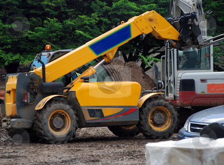 Fork Lift Truck stock photo, A photograph of a fork-lift truck active on an English building site by Philippa Willitts
