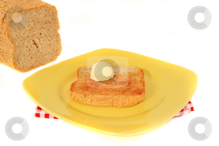 Morning Toast stock photo, Home made wheat bread toast with butter by Jack Schiffer
