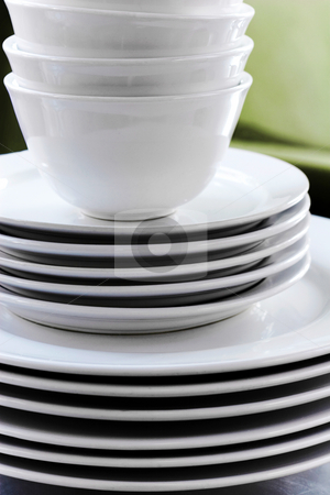 Stack of Clean White Dishes stock photo, Pile of utilitarian commercial grade white plates and bowls by Mark S