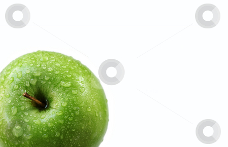 Wet Green Granny Smith Apple On White stock photo, Green apple with water drops cropped in left corner by Mark S