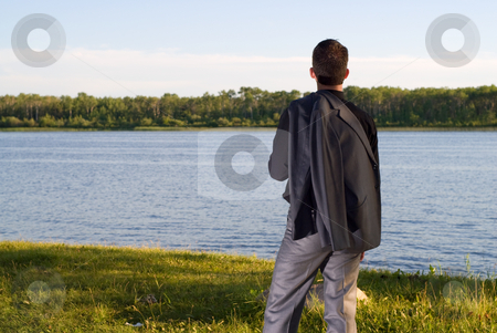 After Work stock photo, A young businessman at the lake after work by Richard Nelson