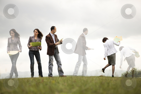 Busy businesss people stock photo, Busy business people on a hill organizing and looking for files by Claudia Veja