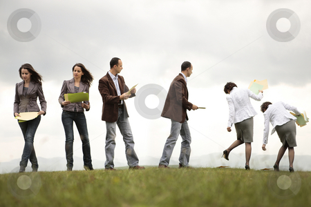Lost in the game stock photo, Busy business people on a hill looking and filling documents by Claudia Veja