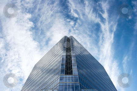 Glass Office Building In Huge Blue Sky stock photo, Office tower set against deep blue sky with white cirrus clouds by Mark S
