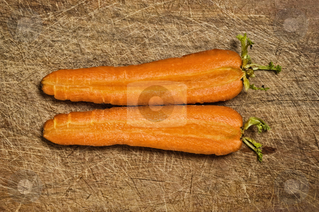 Carrot fresh vegetable stock photo, Cut fresh carrots on old wooden table. by Pablo Caridad