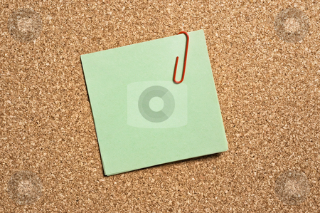 Green paper note stock photo, Green paper note with clip on cork board. by Pablo Caridad