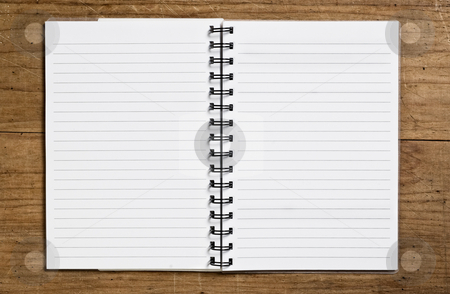 Open spiral notebook stock photo, Open spiral notebook on wooden table. by Pablo Caridad