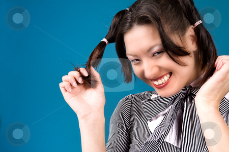 Grinning with my ponytails stock photo, Young girl is happy with her two ponytails by Frenk and Danielle Kaufmann