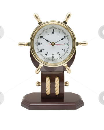 Brass Nautical Clock stock photo, Brass Clock with a nautical theme isolated on a white background by A Cotton Photo