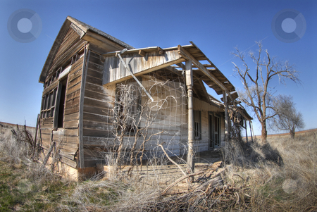 Old house in Texas  stock photo, An old house in the middle of nowhere in Texas under a pristine sky by A Cotton Photo