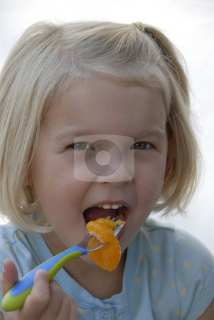 Girl eating with Spoon stock photo, Girl eating with Spoon by A Cotton Photo