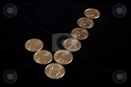 Checkmark Coins stock photo, A checkmark made out of dollar coins by Kevin Tietz