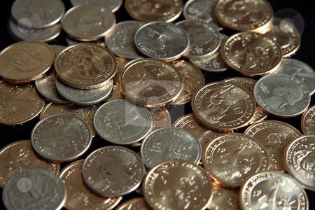 Pile of Coins stock photo, A single pile of gold U.S. one dollar coins and quarters by Kevin Tietz