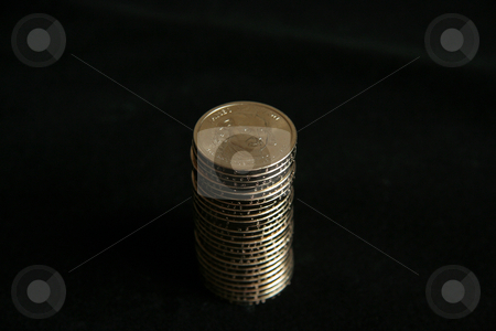 Stack of Coins stock photo, A single stack of gold U.S. one dollar coins by Kevin Tietz