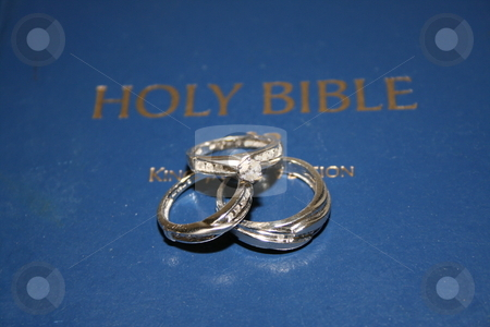 Description Bride 39s and groom 39s wedding rings on a Bible