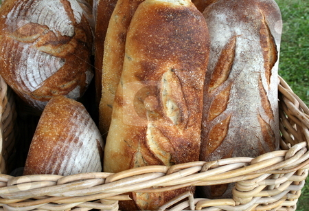 Freshly Baked Organic Bread stock photo, Freshly baked rustic organic bread, in a basket by Tom and Beth Pulsipher