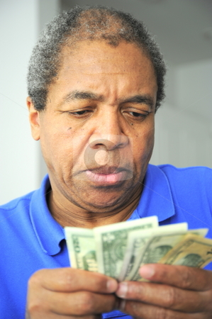 African american male stock photo, African american man counting his money. by OSCAR Williams