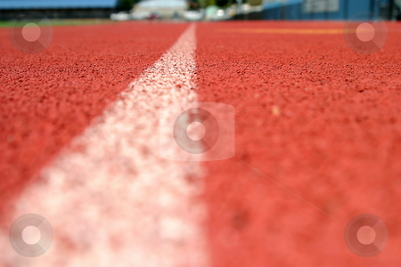 Track Line stock photo, Red running tracks with single white line. by Henrik Lehnerer