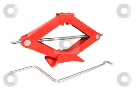 Sicssor Jack stock photo, A horizontal screw that raises or lowers a hinged, diamond-shaped frame used for changing flat tires by Jack Schiffer