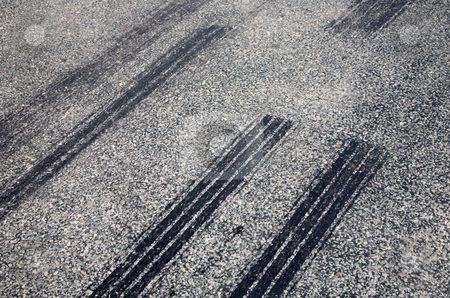 A close up of skid marks on a road. stock photo, A close up of skid marks on a road. by Stephen Rees