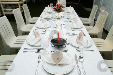 Dining table stock photo, Romantic dining table for nine guests by Jonas Marcos San Luis