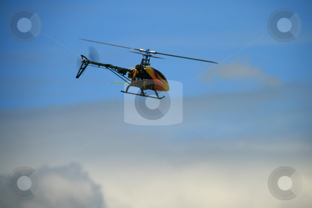 Toy helicopter in flight stock photo, Remote controlled toy helicopter in flight by Jonas Marcos San Luis