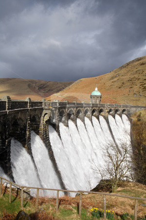 Water overflowing a dam, Craig Goch reservoir, Elan Vally Wales. stock photo, Water overflowing a dam, Craig Goch reservoir, Elan Vally Wales. by Stephen Rees