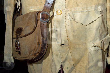 Antique Clothing stock photo, Closeup of an old shirt and leather purse by Richard Nelson