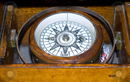 Antique Compass stock photo, An antique compass closed in a dark wooden box by Richard Nelson