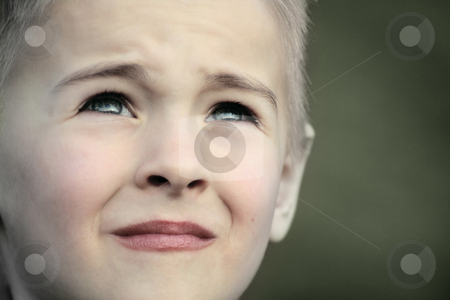 Boy staring up into clouds stock photo, A little boy looking at the sky thinking something like