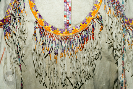 Native American Shirt stock photo, Closeup of a Native American shirt made of animal hide and decorated with beads by Richard Nelson