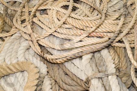 Rope Background stock photo, A background of various sized ropes piled in a heap by Richard Nelson