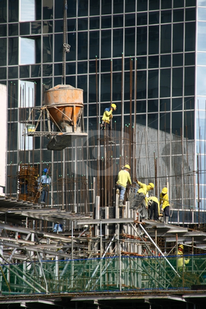 Building construction 2 stock photo, Building construction site with cement bucket  and workers by Jonas Marcos San Luis