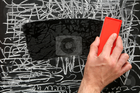Cleaning a blackboard with a red chalk duster. stock photo, Cleaning a blackboard with a red chalk duster. by Stephen Rees