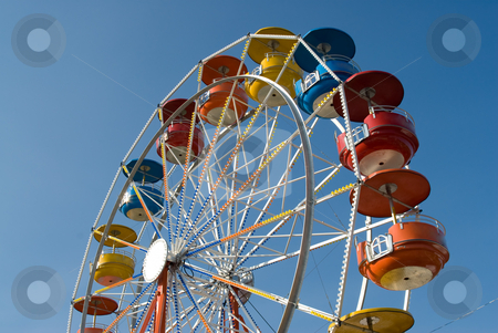 Ferris Wheel stock photo, Low angle view of a large ferris wheel shot against the blue sky by Richard Nelson