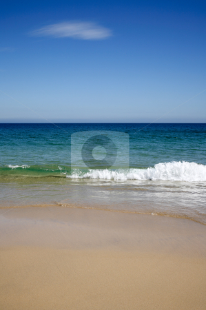 Blue sky and a wave breaking on the sandy beach in Carbis Bay, Cornwall UK. stock photo, Blue sky and a wave breaking on the sandy beach in Carbis Bay, Cornwall UK. by Stephen Rees
