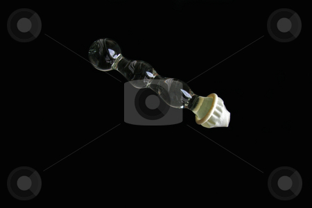 Glass Sex Toy stock photo, A bumpy glass sex toy or dildo with a condom by Kevin Tietz