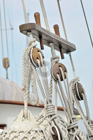 Vintage sailboat detail stock photo, Close-up of wooden tools and ropes of a boat by Massimiliano Leban