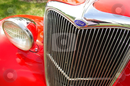 Red Vintage 1934 Ford Grille stock photo, The front-end of this 1934 Ford coupe shows how a vintage car can be restored and brought back to life with skill, hard work,  and money. by Dennis Thomsen