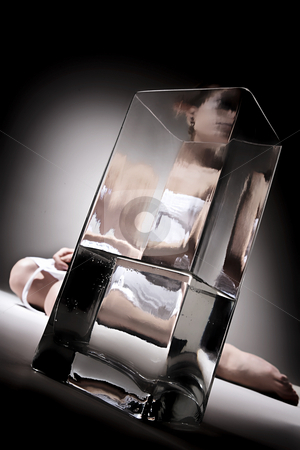 Through the glass stock photo, Model posing and play through a glass jar by Luca Mosconi