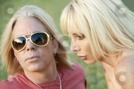 Rock and Roll Couple stock photo, Close up shot of hip adult couple outdoors by Scott Griessel