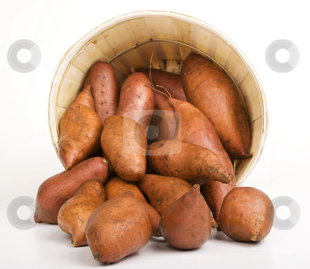 Sweet Potatoes stock photo, Red Sweet Potatoes pouring out of a Woven Basket by Scott Griessel