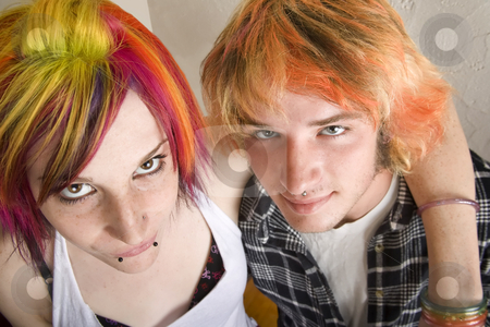 Young Couple with Bright Colored Hair Embrace stock photo, Portrait of Young Couple with Bright Colored Hair Embracing by Scott Griessel