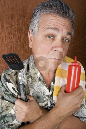 Barbecue Man stock photo, Latin American Man with Barbecue Implements and a Ketchup Bottle by Scott Griessel