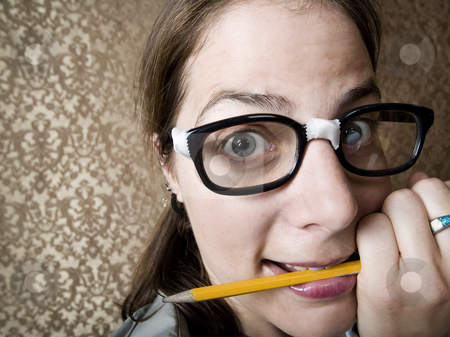 Nervous Nerdy Woman stock photo, Nervous nerdy Woman Chewing on a Yellow Pencil by Scott Griessel
