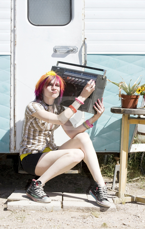 Girl Sitting on a Trailer Step stock photo, Punk girl with brightly colored hair sitting on trailer step holding boom box by Scott Griessel