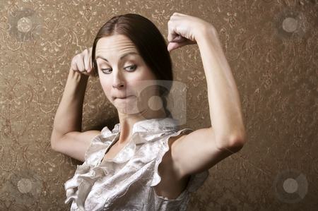 Young Woman Admiring Her Bicep stock photo, Pretty Young Woman Admiring Her Flexed Biceps by Scott Griessel