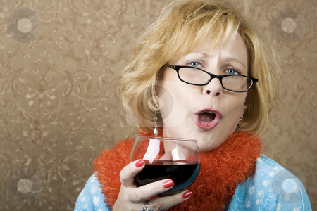 Funny Woman Drinking Wine stock photo, Extroverted woman with a funny expression drinking red wine by Scott Griessel