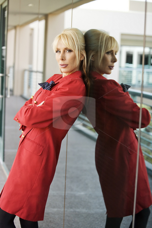 Beautiful Blonde Businesswoman stock photo, Blonde Businesswoman leaning against a reflective surface by Scott Griessel